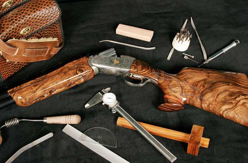 Custom Gun and Working Tools Surrounding It